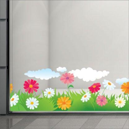 Αυτοκόλλητη μπορντούρα βιτρίνας με λουλούδια και συννεφα