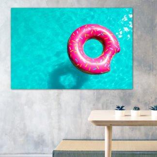 Πίνακας σε καμβά Φουσκωτό ντόνατ σε πισίνα